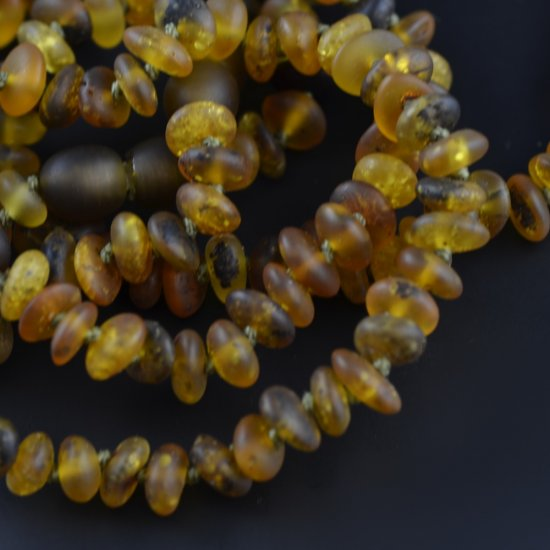 Raw green flat beads with knots and clasp
