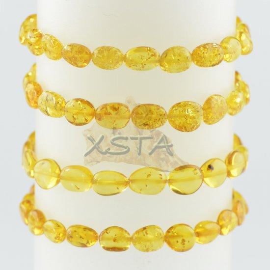 Yellow olive amber bracelet polished
