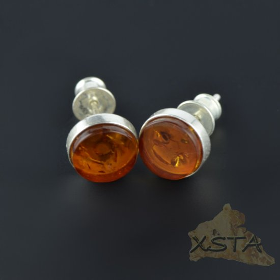 Stud amber earrings with Cognac color