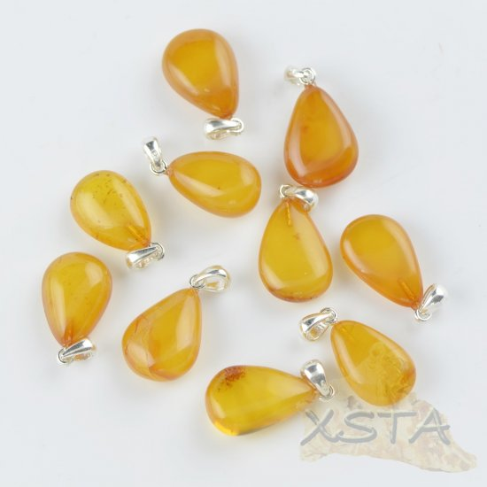Natural teardrop amber pendant with silver 925
