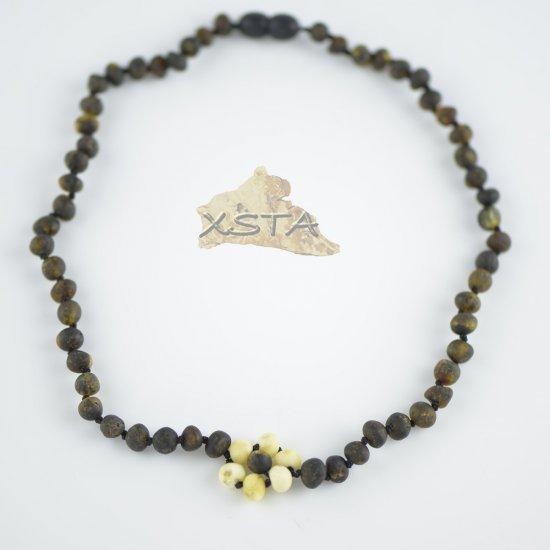 Dark green necklace with white flower