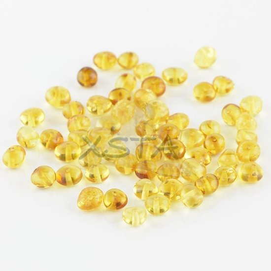 Polished honey baroque amber beads 4-6 mm