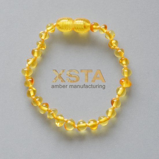 Amber teething bracelet baroque light honey polished