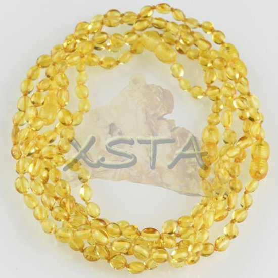 Olive polished yellow teething Amber necklace